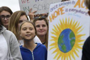 Swedish youth climate activist Greta Thunberg, center in blue, joins other young climate activists Friday for a climate strike outside the White House in Washington, Friday, Sept. 13, 2019. (AP Photo/Susan Walsh)